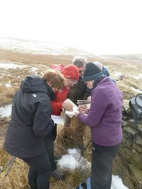 National Navigation Award Scheme participants gathered round a map