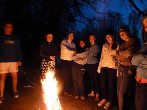 Duke of Edinburgh students around campfire