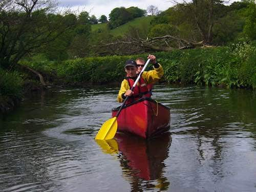 Two adults river canoeing