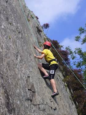 Young person rock climbing