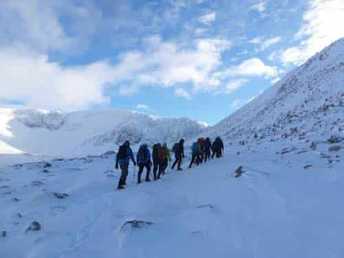 Walking group in the snowy mountains