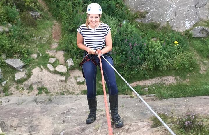 Woman abseiling at Tegg's Nose Country Park