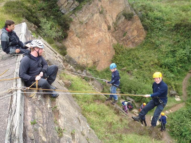 Family abseiling at Tegg's Nose Country Park